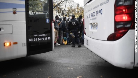 Police evacuate migrants Friday from a makeshift camp outside the Stalingrad metro station in Paris.