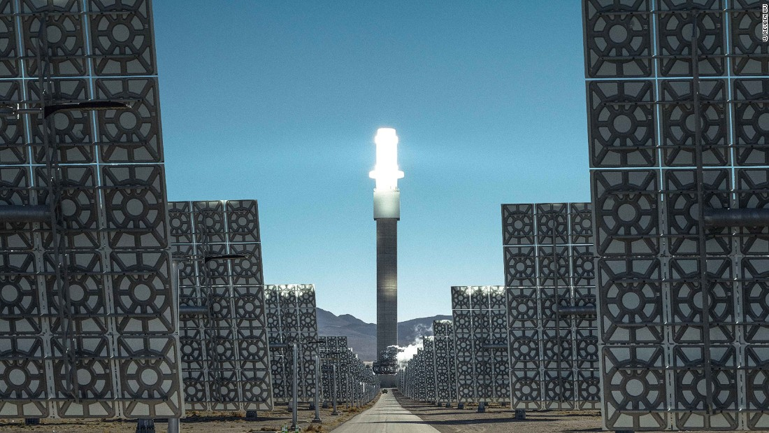 A vast array of heliostats track the sun from dawn to dusk, directing sunlight at a central power tower which converts the sun's rays into electricity.