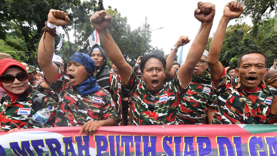 Muslim protesters march on Jakarta's governor's office on Friday, November 4. Tens of thousands of Muslims descended upon the Indonesian capital demanding Jakarta governor Basuki Tjahaja Purnama be prosecuted on accusations that he committed blasphemy.