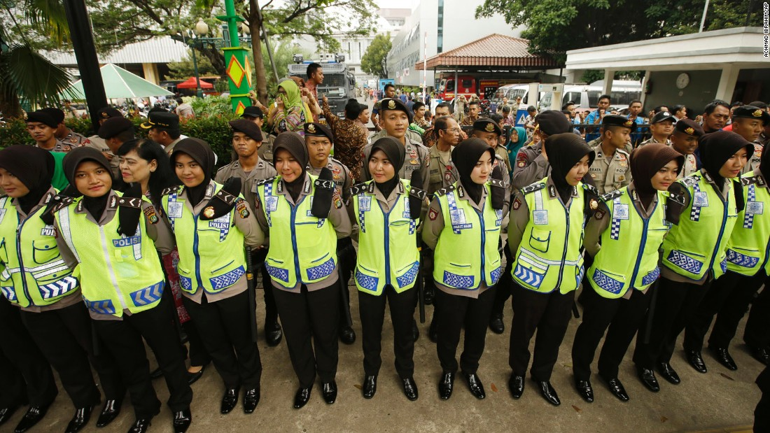 Indonesian policewomen stand guard during the protest outside Jakarta's City Hall on November 4.
