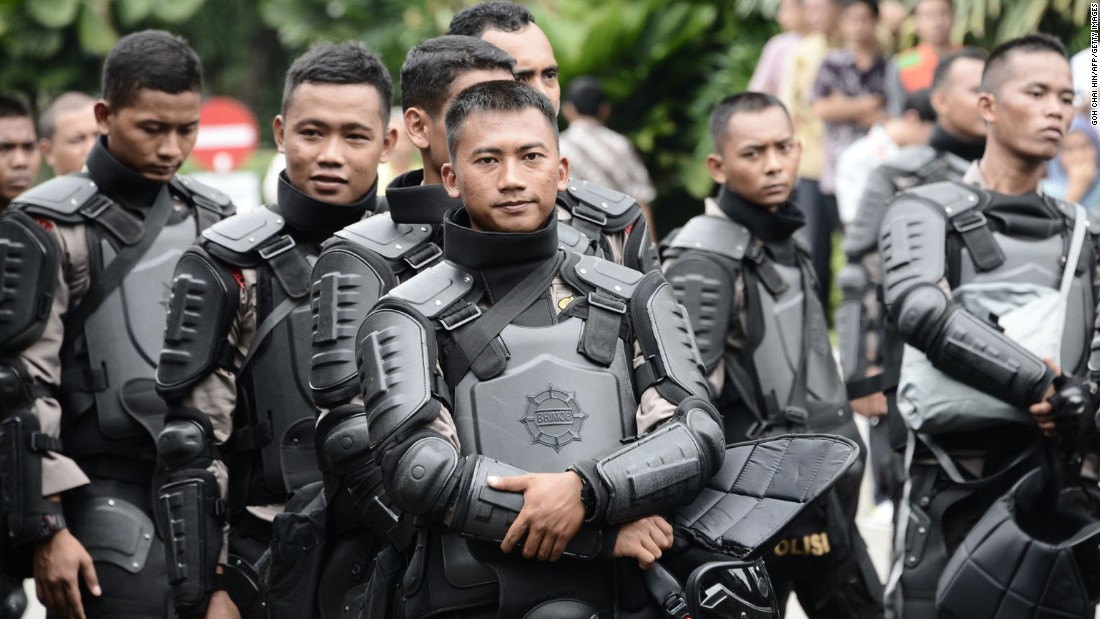 Indonesian riot police are on standby in the compound of the governor's office on November 4.