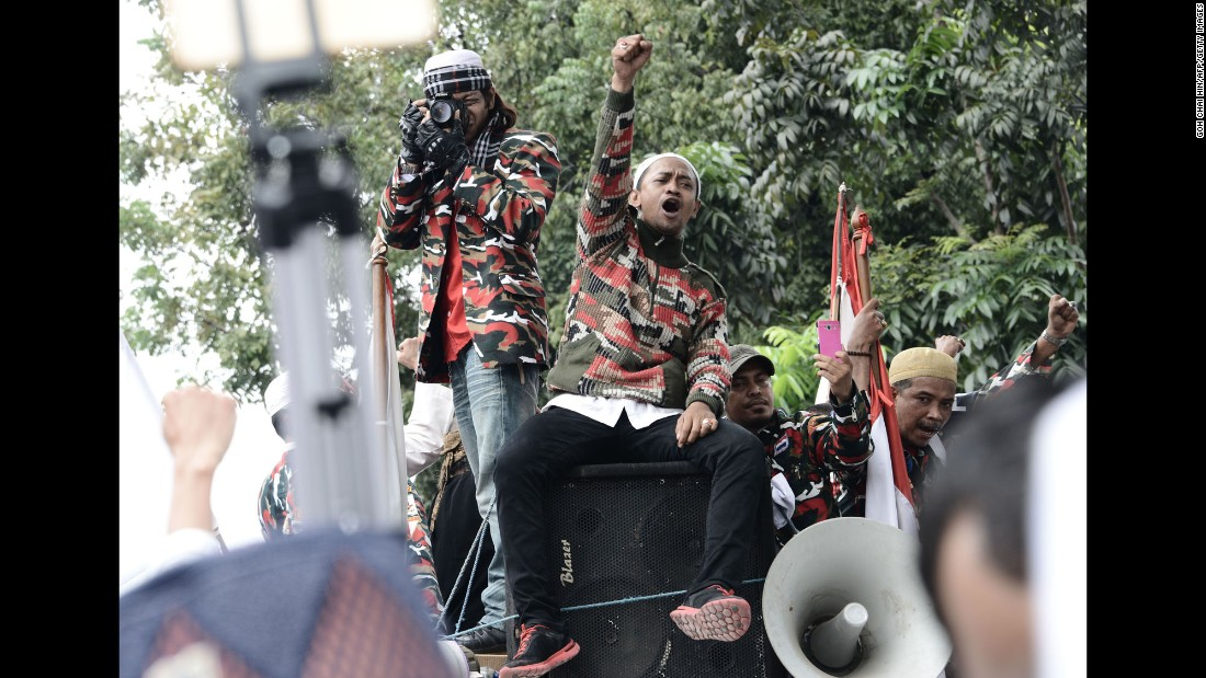 Protesters sit atop a speaker system during the demonstration on November 4.
