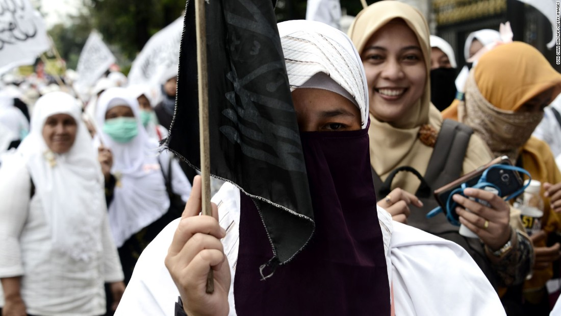 Female Muslim protesters march outside the governor's office on November 4.