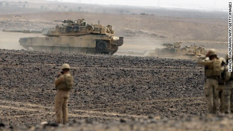 "Soldiers watch tanks advancing as they take part in joint Jordan-US maneuvers during the ""Eager Lion"" military exercises in Mudawwara, near the border with Saudi Arabia, some 280 kilometers south of the Jordanian capital, Amman, on May 18, 2015."