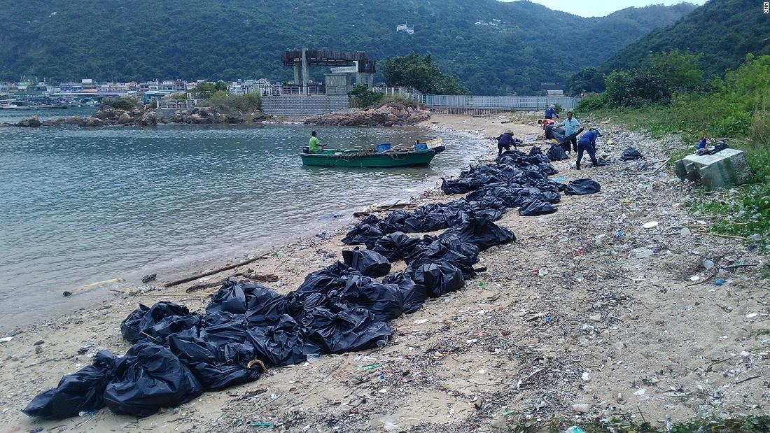 Trash being cleaned up on Sok Ku Wan beach.