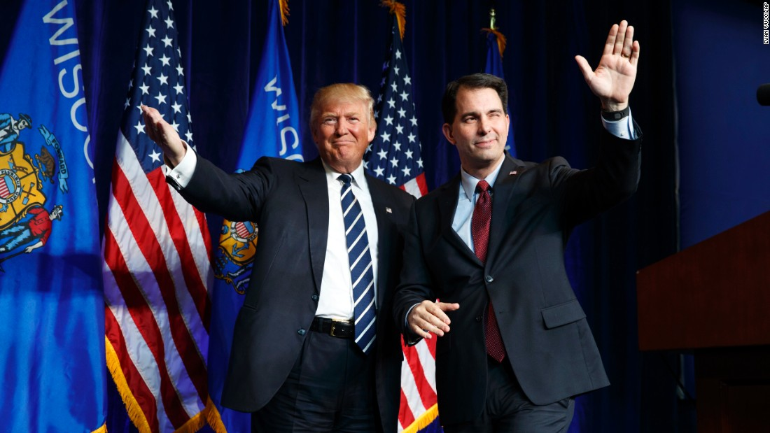 Wisconsin Gov. Scott Walker winks after introducing Republican presidential nominee Donald Trump at a campaign rally in Eau Claire, Wisconsin, on Tuesday, November 1.