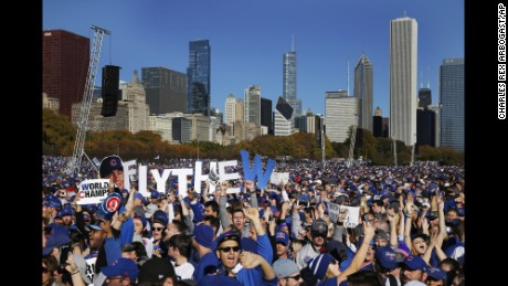 Chicago Cubs fans celebrate during a rally in Grant Park honoring the World Series champions Friday in Chicago. (AP Photo/Charles Rex Arbogast)