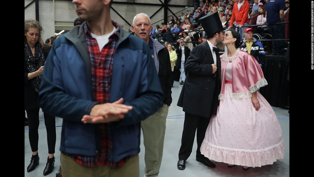 Matthew and Birgit Peterson, celebrating their second wedding anniversary, dress up as former US President Abraham Lincoln and first lady Mary Todd Lincoln during a Donald Trump campaign rally in Grand Rapids, Michigan, on Monday, October 31.