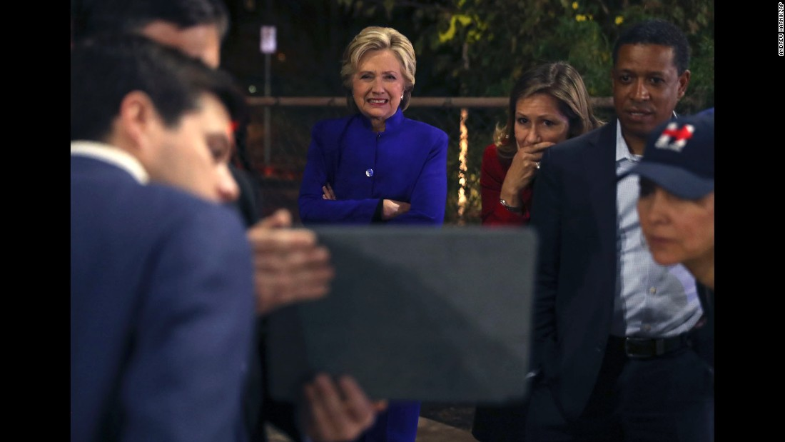 "Hillary Clinton watches Game 7 of the <a href=""http://www.cnn.com/2016/10/25/sport/gallery/world-series-2016/index.html"" target=""_blank"">World Series</a> after her campaign rally in Tempe, Arizona, on Wednesday, November 2."