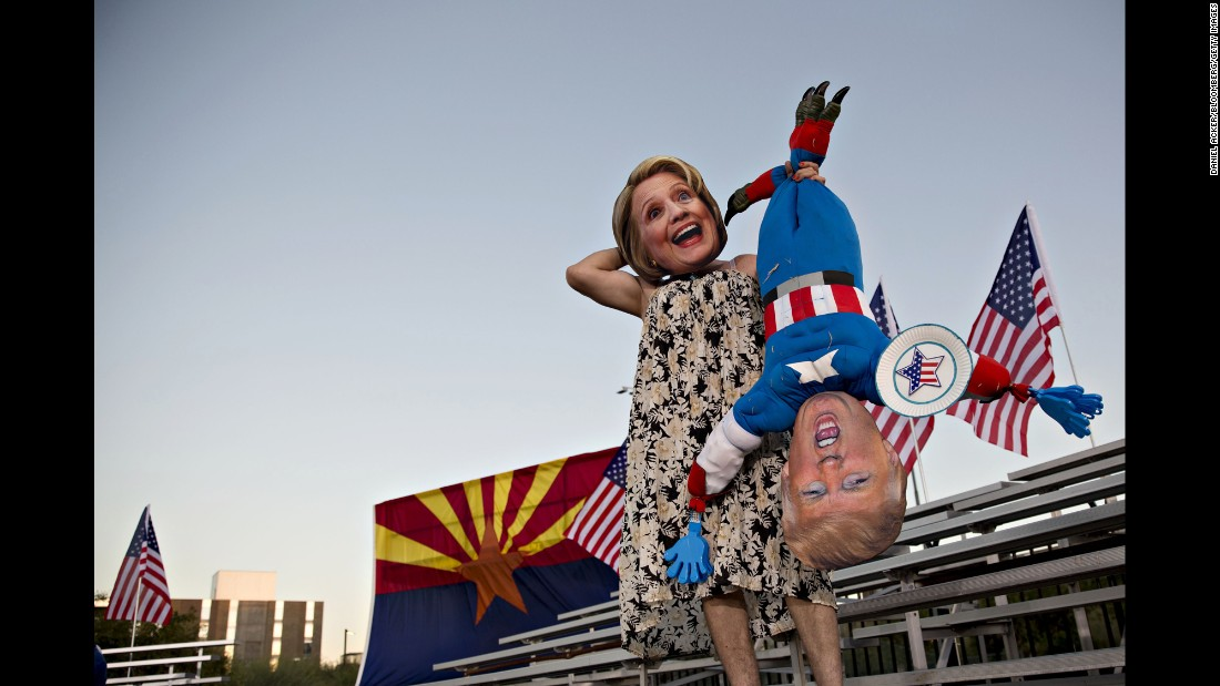 A person in a Hillary Clinton mask holds an effigy of Donald Trump before a Clinton campaign event in Tempe, Arizona, on Wednesday, November 2.