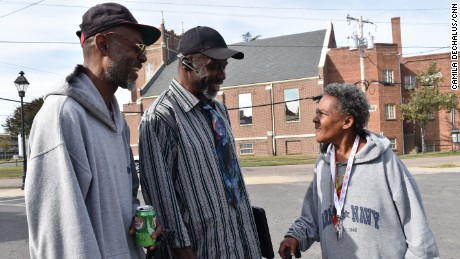From left, Howard Robinson, Muhamad As-saddique Abdul-Rahman and Katrina Miller speak in the Blackwell neighborhood of Richmond, Virginia, on October 30, 2016.