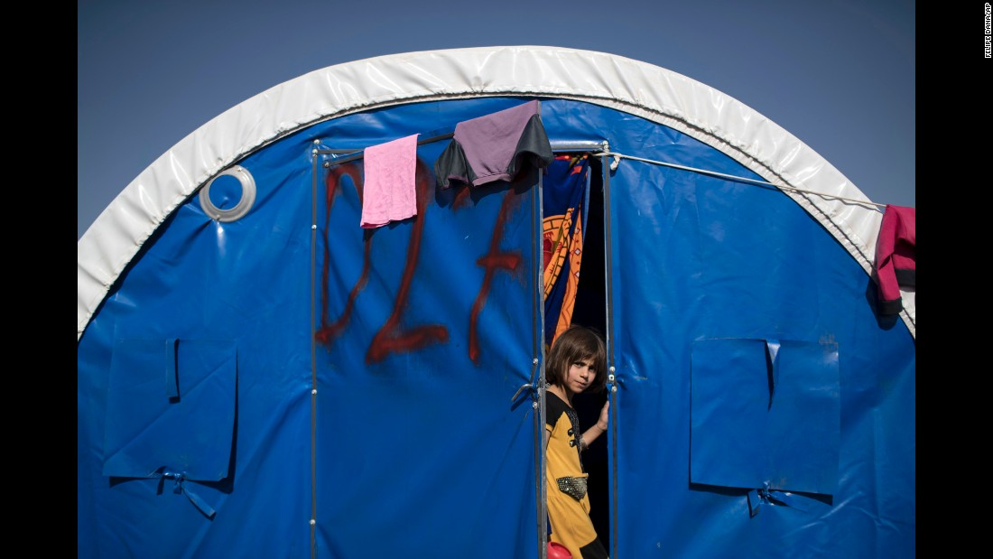 A girl pauses in the doorway of a tent in the Khazer camp on November 4.