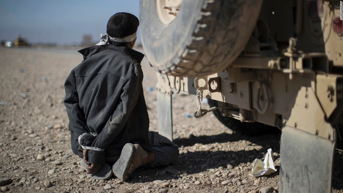 A suspected member of ISIS is detained at a checkpoint near Bartella, Iraq, on November 4.