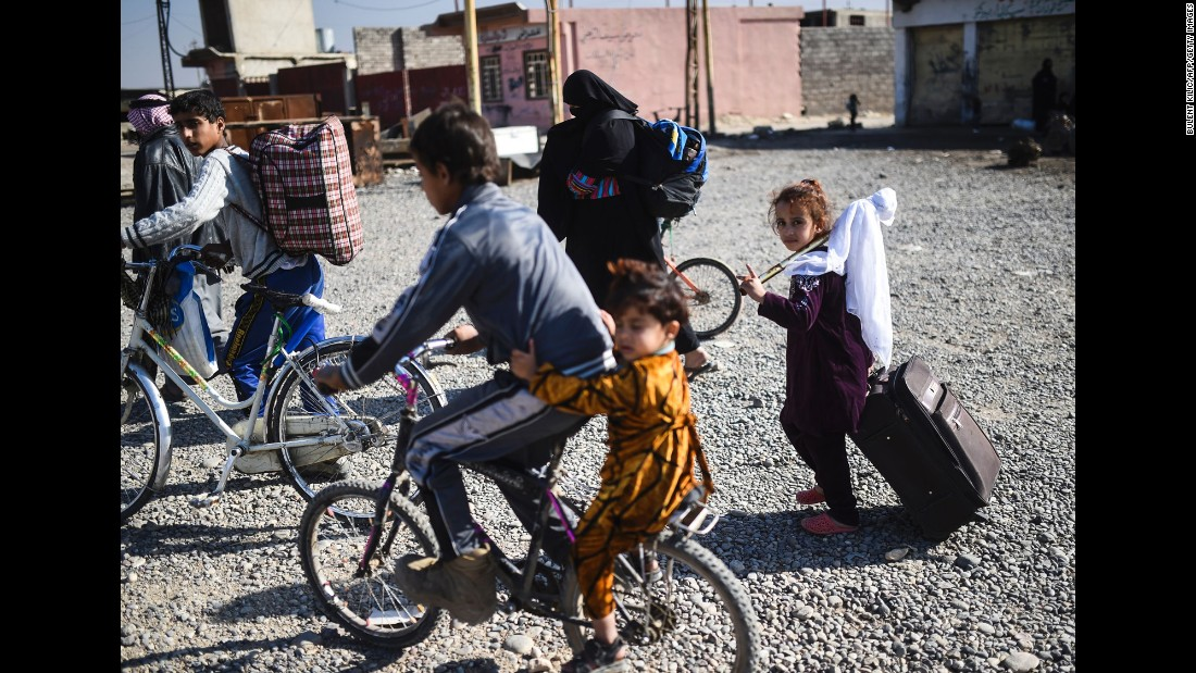 Iraqi families flee the fighting on November 4 near the village of Gogjali.