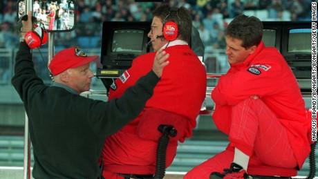 Ross Brawn (center), says he's not spoken to Niki Lauda (left) since he left Mercedes