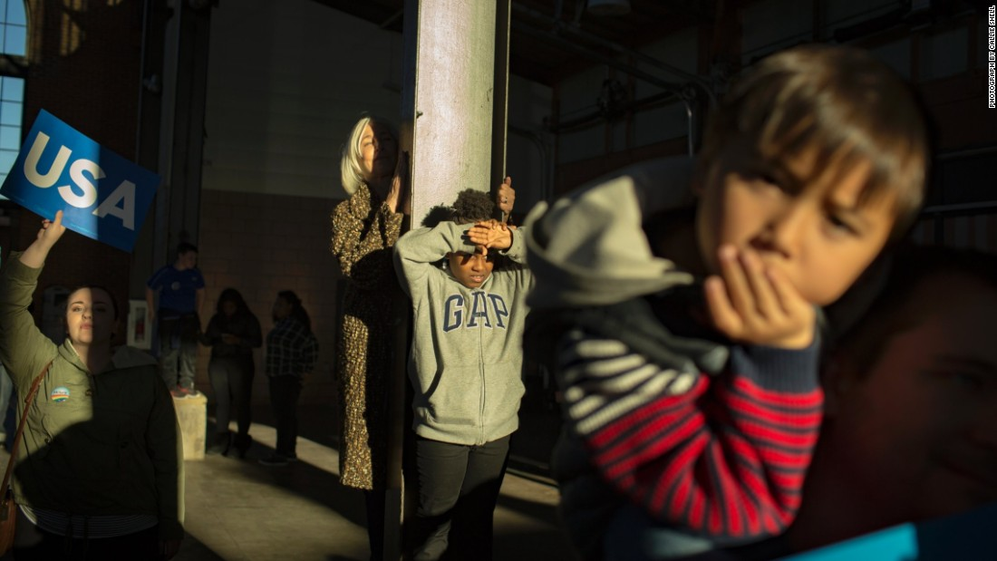 Children wait for the start of a Clinton rally in Detroit on Friday, November 4.