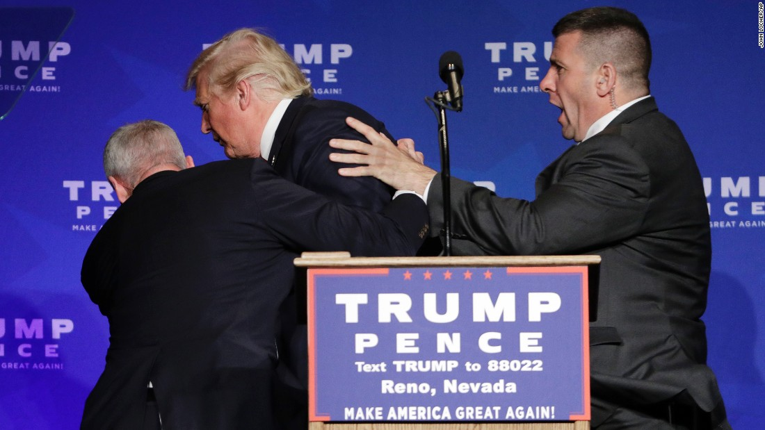 "Members of the Secret Service rush Republican presidential candidate <a href=""http://www.cnn.com/2016/11/05/politics/trump-rushed-off-stage-at-campaign-rally/index.html"" target=""_blank"">Donald Trump off the stage</a> at a campaign rally in Reno, Nevada, on Saturday, November 5."