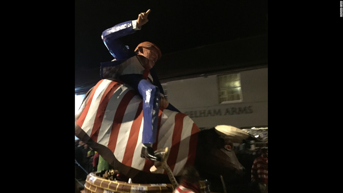 An effigy of Trump riding a bucking bull draped in the Stars and Stripes is paraded down the street in Lewes on November 5.