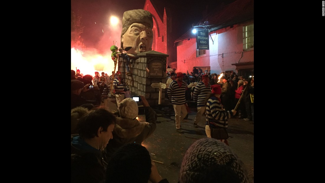 """This effigy portrays the Republican presidential nominee as """"Humpy Trumpty"""" sitting on his wall. Trump's proposal for a wall between Mexico and the United States has been a centerpiece of his campaign."""