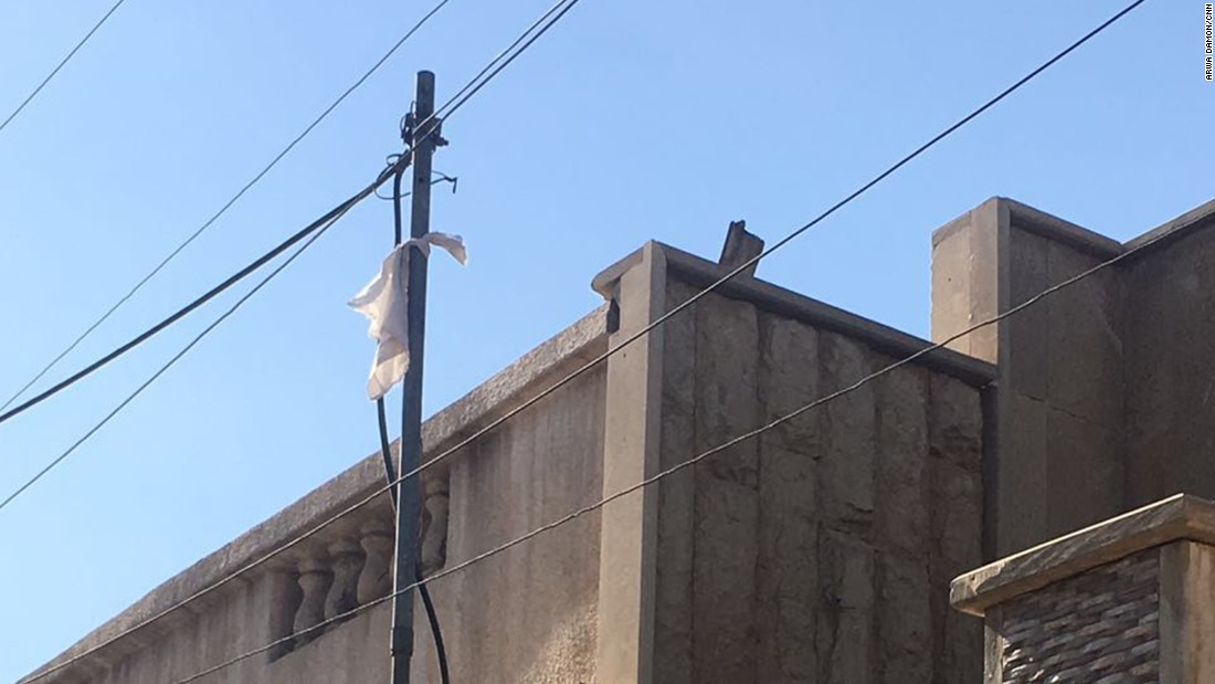 A white rag was hung outside a home next to where Arwa and her team are stationed.