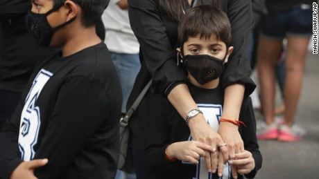 Children wear pollution masks at a protest against air pollution in New Delhi on Sunday.