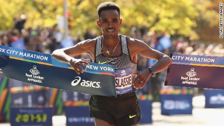 Ghirmay Ghebreslassie of Eritrea celebrates as he crosses the finish line.