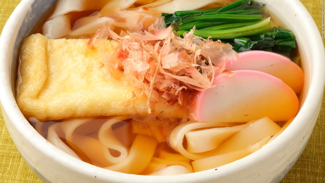 Kishimen are broad, flat noodles served with a broth that features a touch of sweet sake seasoning. Dried bonito shavings are tossed on the dish before serving.