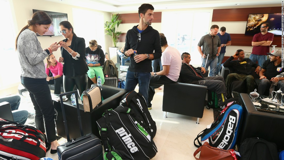 In the same lounge, Novak Djokovic is pictured surrounded by players' racket bags -- a sizable piece of cargo to lug around the world.