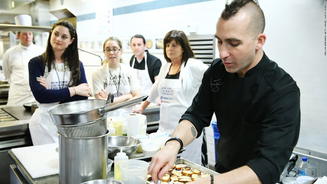 "In 2010, Forgione won Season 3 of ""The Next Iron Chef."" Pictured here he teaches ""Reinventing Classic Comfort Food"" at the New York Culinary Experience in May 2013."
