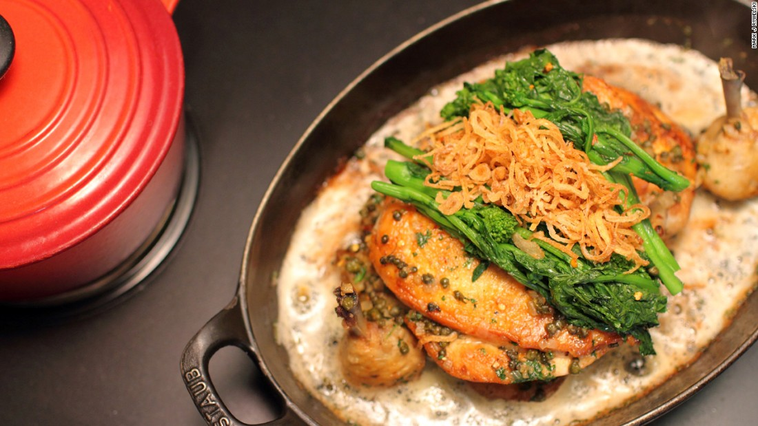 """At the age of 16 Marc began working alongside his father, chef Larry Forgione, at the """"An American Place"""" restaurant in New York City. Pictured, Marc's signature chicken under a brick. <em>Photo c<em></em>ourtesy Mark J Rywelski</em>."""