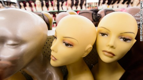 Wigs are displayed in a large wig salesroom in Finsbury Park, north London, on September 10, 2013.  AFP PHOTO / LEON NEAL        (Photo credit should read LEON NEAL/AFP/Getty Images)