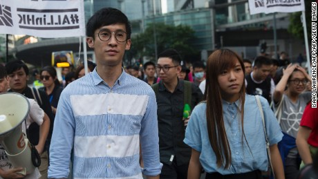 Baggio Leung (L) and Yau Wai-ching (R) of the Youngspirations organisation march during a protest in Hong Kong on November 6, 2016. Hong Kong police used pepper spray November 6 to drive back hundreds of protesters angry at China's decision to intervene in a row over whether two pro-independence lawmakers should be barred from the city's legislature. In chaotic scenes reminiscent of mass pro-democracy protests in 2014, demonstrators charged metal fences set up by police outside China's liaison office in the semi-autonomous city. / AFP / ISAAC LAWRENCE        (Photo credit should read ISAAC LAWRENCE/AFP/Getty Images)
