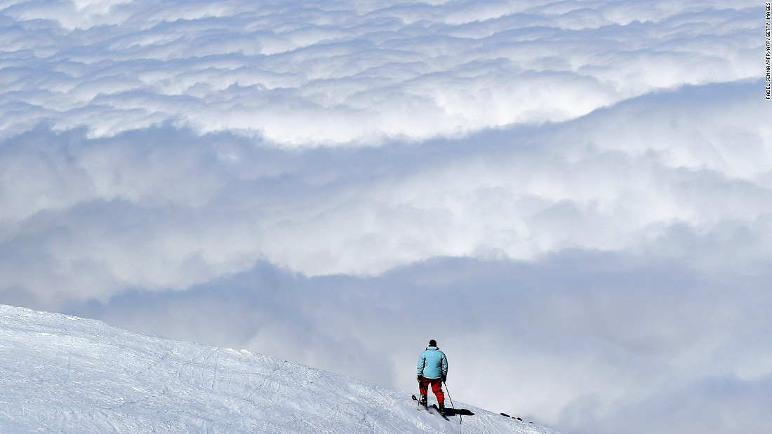 Low lying clouds obscure views of the Sahara for a skier in Oukaimeden. Topping out at 10,603 feet, the resort's skiable terrain is even higher than Val Thorens in France, one of Europe's most snow-sure destinations.