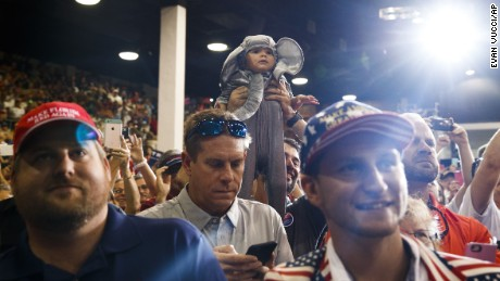 A child is held in the air as Republican presidential candidate Donald Trump arrives to speak during a campaign rally, Monday, Nov. 7, 2016, in Sarasota, Fla. (AP Photo/ Evan Vucci)