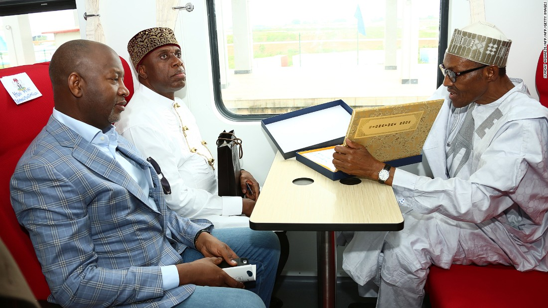 Nigerian President Mohammadu Buhari (right) signs visitor's register during an opening ceremony in July 2016. China Exim bank loaned $500 million toward the railway, which cost a total of $874 million, according to SAIS.