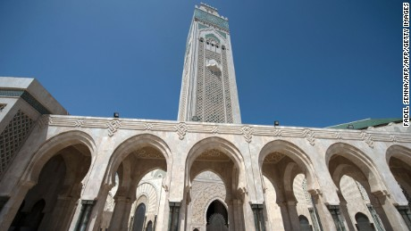 Muslim worshippers walk at the Hassan II mosque on September 6, 2016  in the coastal Moroccan city of Casablanca. Two months before it hosts the COP22 climate conference, Morocco is preparing to launch an ambitious project to turn its mosques green as a commitment to clean energy. / AFP / FADEL SENNA        (Photo credit should read FADEL SENNA/AFP/Getty Images)