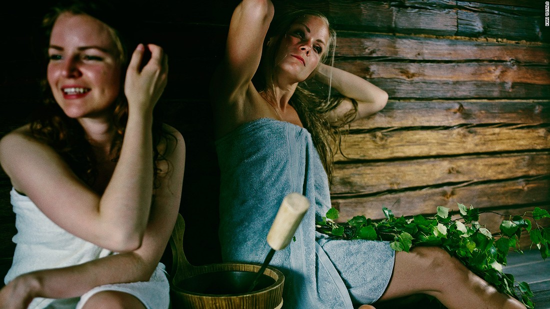 A traditional Finnish sauna is made of pinewood and is dimly lit. Sauna-goers should sit on their towels; naked skin shouldn't touch the wood.