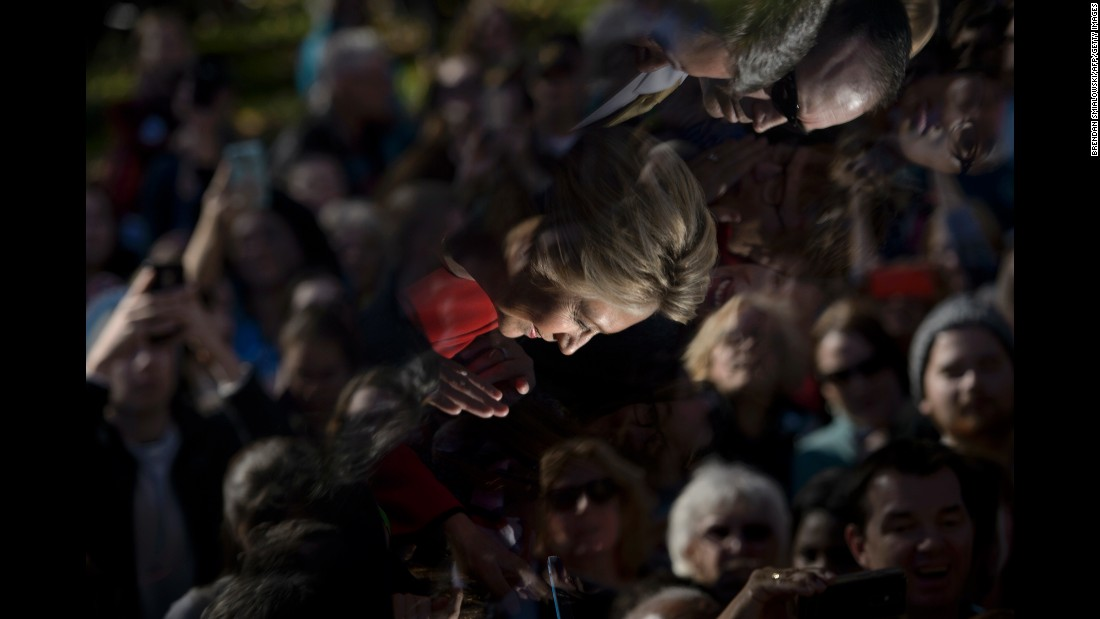 Clinton's image is reflected in a teleprompter as she greets supporters after a rally in Pittsburgh on November 7.