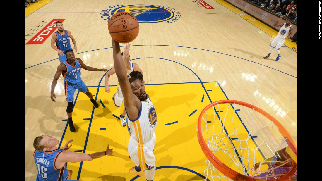 Golden State's Kevin Durant dunks the ball against Oklahoma City during an NBA game in Oakland, California, on Thursday, November 3. Durant scored 39 points in his first game against his former team, and Golden State won 122-96.