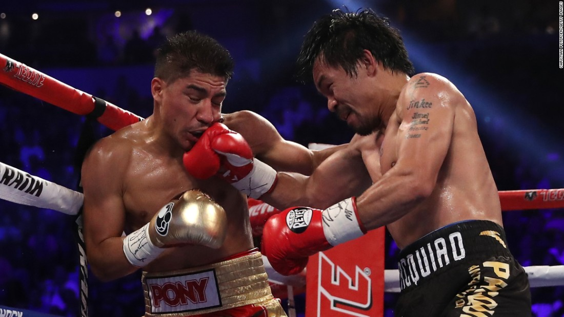 Manny Pacquiao punches Jessie Vargas during their welterweight title fight on Saturday, November 5. Pacquiao won by unanimous decision.