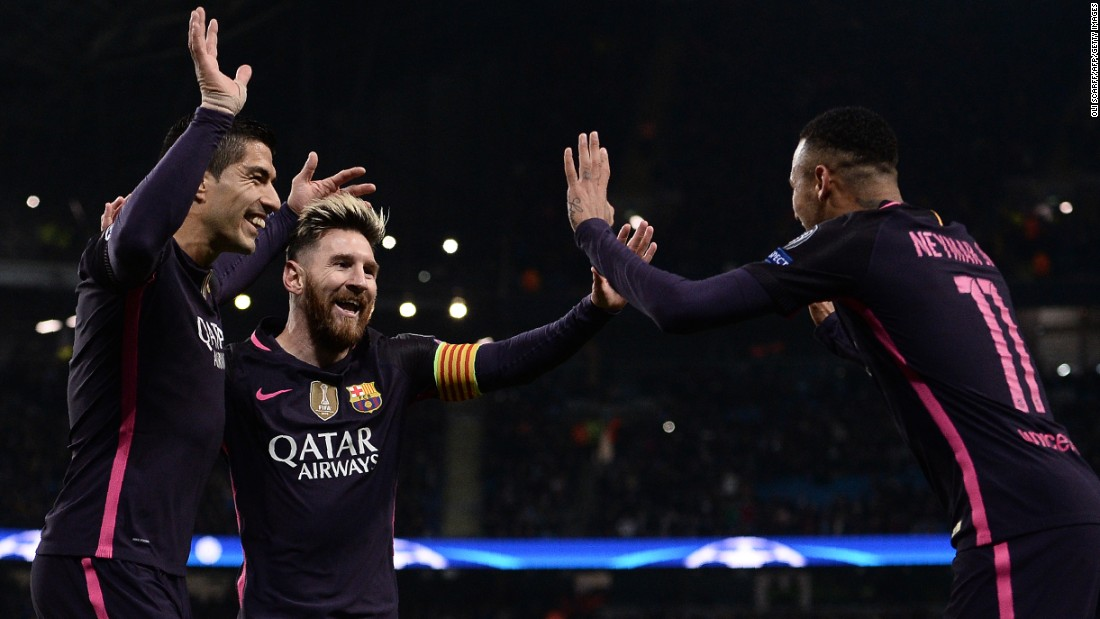 Barcelona's attacking trident -- from left, Luis Suarez, Lionel Messi and Neymar -- celebrate Messi's goal against Manchester City during a Champions League match in Manchester, England, on Tuesday, November 1. Manchester City won the match 3-1.