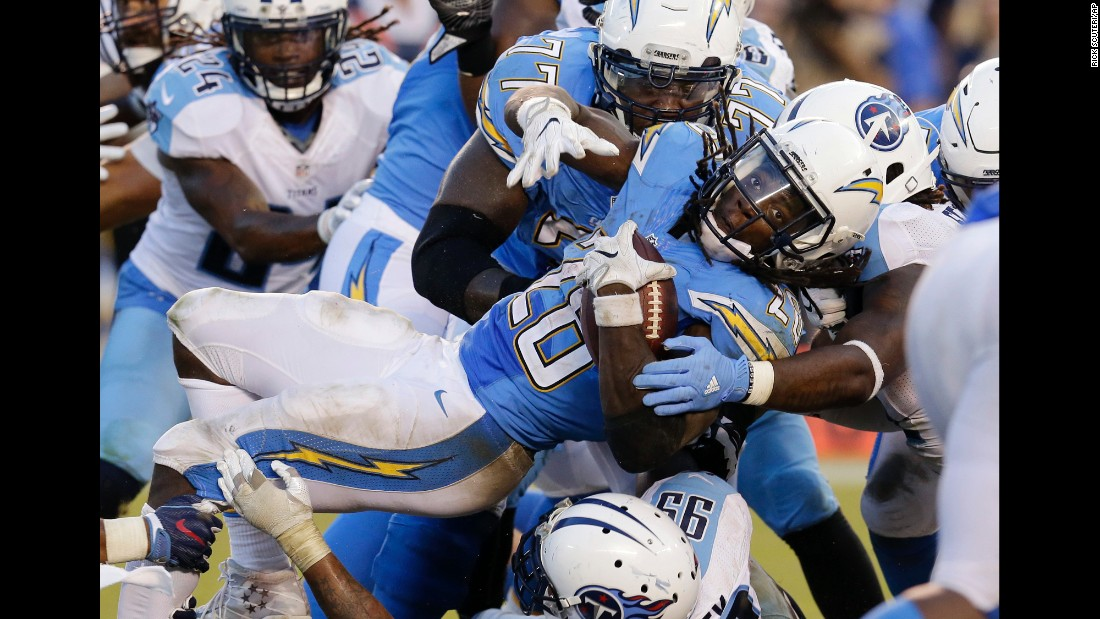 San Diego running back Melvin Gordon is tackled by Tennessee Titans during an NFL game in San Diego on Sunday, November 6. Gordon rushed for 196 yards and a touchdown as the Chargers won 43-35.