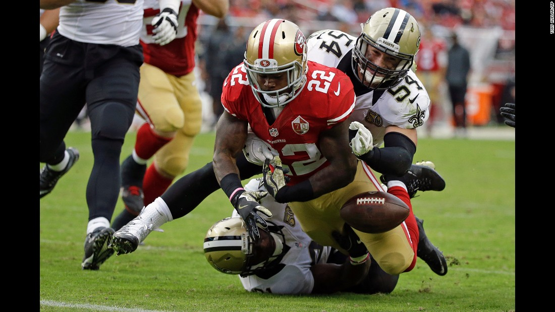 San Francisco running back Mike Davis fumbles near the goal line during an NFL game against New Orleans on Sunday, November 6.