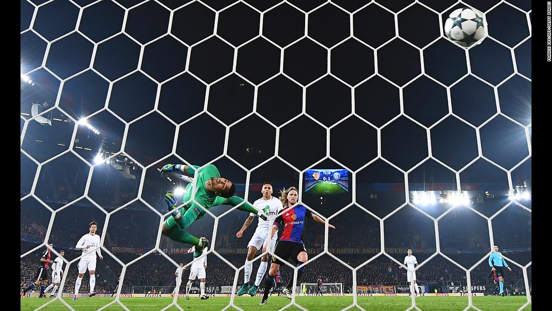 Alphonse Areola, goalkeeper for Paris Saint-Germain, watches the ball go into his net during a Champions League match in Basel, Switzerland, on Tuesday, November 1. PSG defeated Basel 2-1.