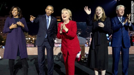 Democratic presidential candidate Hillary Clinton, center, is joined on stage by first lady Michelle Obama, left, President Barack Obama, second from left, Chelsea Clinton, second from right, and former President Bill Clinton, right, after speaking at a rally at Independence Mall in Philadelphia, Monday, Nov. 7, 2016. (AP Photo/Andrew Harnik)
