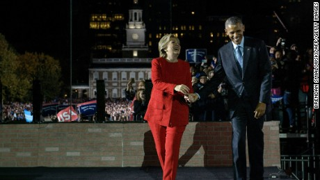Democratic party nominee Hillary Clinton walks on stage with US President Barack Obama during a rally for Democratic presidential nominee Hillary Clinton, on Independence Mall, November 7, 2016 in Philadelphia, Pennsylvania.