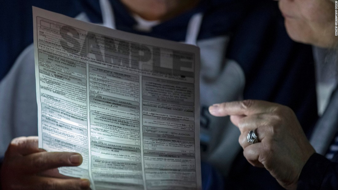 Voters look at a sample ballot at a polling location in Independence, Missouri.