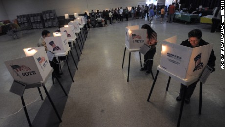Sun Valley residents vote at the polling station located at Our Lady of The Holy Church on election day at the Sun Valley's Latino district, Los Angeles County, on November 6, 2012 in California. AFP PHOTO /JOE KLAMAR        (Photo credit should read JOE KLAMAR/AFP/Getty Images)