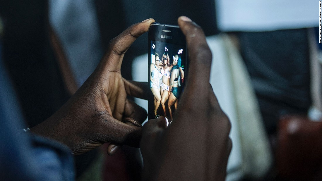 """I've always been plus size and it's always bothered me that there were never images of people who looked like me in the media,"" founder of empowerment platform 'About That Curvy Life' Latasha Ngwube tells CNN.<br />Pictured: A man photographs plus-size models at LFDW in October 2016. Photo: Stefan Heunis/AFP/Getty Images"