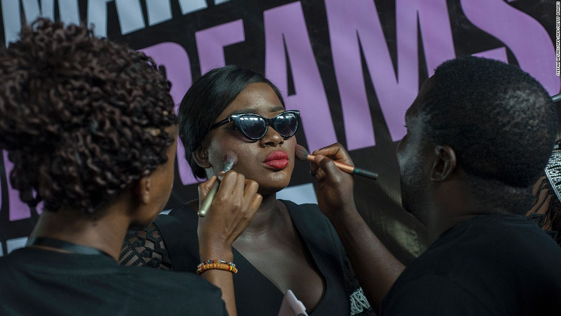 """We've already got curvy bodies, there's no need for us to come out there and try to be overtly sexy,"" says Ngwube. <br />Pictured: Models get made up backstage at LFDW. Photo: Stefan Heunis/AFP/Getty Images"